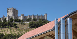 Modern building against old spanish castle Royalty Free Stock Images