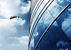 Modern building and aircraft Royalty Free Stock Photos