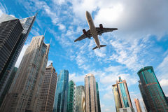 Modern building with airplane under the blue sky Stock Photos