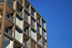 Modern building. Modern apartment building in sunny day against blue sky stock image