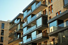 Modern building. Modern apartment building in sunny day against blue sky stock images