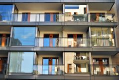 Modern building. Modern apartment building in sunny day against blue sky royalty free stock image