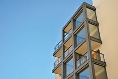 Modern building. Modern apartment building in sunny day against blue sky royalty free stock photo