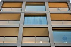 Modern building. Modern apartment building in sunny day against blue sky royalty free stock photos