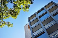 Modern building. Modern apartment building in sunny day against blue sky royalty free stock images