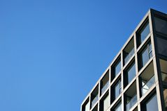Modern building. Modern apartment building in sunny day against blue sky royalty free stock photography