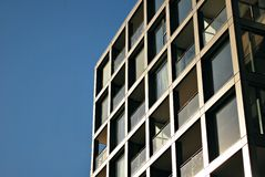 Modern building. Modern apartment building in sunny day against blue sky stock photography