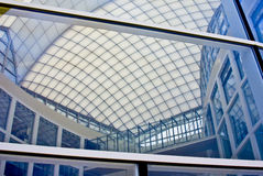 Modern Building with Atrium. Abstract patterns formed by reflections of modern architecture stock photos