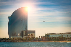 Modern building in Barcelona. Flying plane nad modern building in Barcelona by the beach Royalty Free Stock Photos