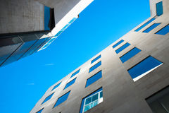 Modern building in Barcelona. Up view of the modern building with two planes on the blue sky Royalty Free Stock Image