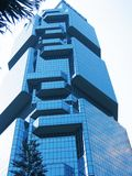 Modern Building in Blue. Multi-faceted office tower Royalty Free Stock Image