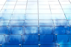 Modern building with blue glass Stock Photos