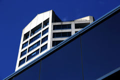 Modern building and blue sky. A modern building and blue sky in the background Royalty Free Stock Images