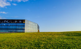 Modern building. Blue sky and green grass Stock Image