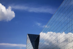 Modern building and blue sky reflection Royalty Free Stock Photos