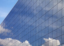 Modern building and blue sky reflection Stock Photography