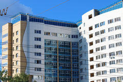 Modern building with blue windows and many wires in city Royalty Free Stock Photo