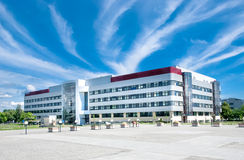 Modern building. Modern, brand-new building agaisnt blue sky coverd with abnormal clouds Stock Image