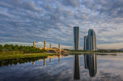 Modern Building and Bridge I. Modern building, bridge and clouds with reflection on the lake surface Royalty Free Stock Images