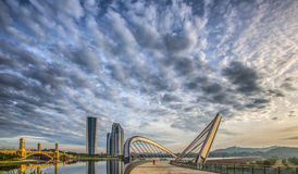 Modern Building and Bridge III. Modern building, bridge and clouds with reflection on the lake surface Stock Images