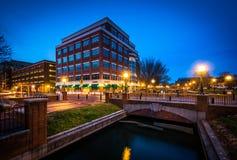 Modern building and bridge over Carroll Creek at night, at Carro Stock Photo