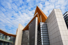 Modern building in cloudy sky Royalty Free Stock Photos