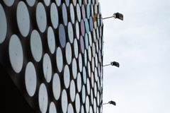 Modern Building Coated With Metallic Discs Pattern Stock Images