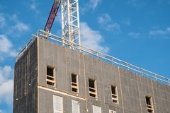 Modern building construction. With some clouds in the blue sky Royalty Free Stock Image