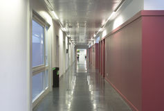 Modern building corridor with red wall Stock Photos