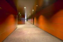 Modern building corridor in warm tones Royalty Free Stock Image