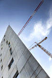 Modern building and cranes Stock Photo