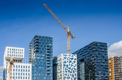 Modern building with cranes at Oslofjord Royalty Free Stock Photography