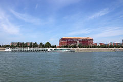 Modern building and cruiser on Danube river Stock Photography