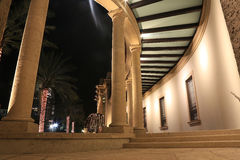 Modern Building Curves With Columns. Building curves with columns, illuminated at night Stock Images