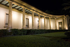 Modern Building Curves With Columns. Illuminated at night Stock Images