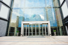 Modern building entrance. With city reflection on wall royalty free stock photography
