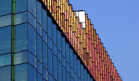 Modern building exterior. Contemporary building design with glass windows and blue sky Stock Photography