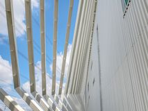 Modern Building Exterior Using White Corrugated Wall and Angled Welded Steel Frames. Low Angle View of Modern Building Exterior Using White Corrugated Wall and royalty free stock photography