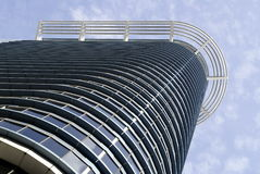 Modern building facade. With curved top and shiny windows. Location in Singapore Royalty Free Stock Image