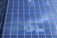 Modern building facade. Modern building glasses with sky reflection Royalty Free Stock Images