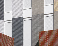 Modern building facade detail with multicolored bricks Royalty Free Stock Image