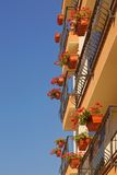 Modern Building With Floral Hanging Baskets On the Balconies Rai Royalty Free Stock Image