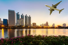 Modern building with flower and airplane under the sky at twilig Stock Photography