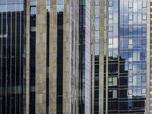 a modern building with a glass facade stock photos