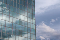 Modern Building Glass Facade Reflecting Cloudy Blue Sky Stock Photo