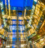 Modern building glass night reflections. Corporate and business Royalty Free Stock Image
