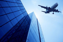 Modern building glass wall. Aircraft in the sky Stock Photos
