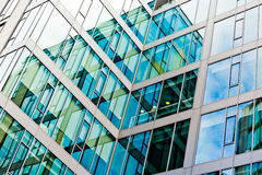 Modern building. Glass windows in building, abstract image of architecture Stock Photo