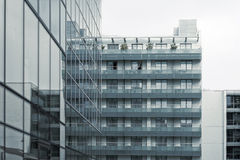 Modern building. Glass windows in building, image of architecture Royalty Free Stock Image