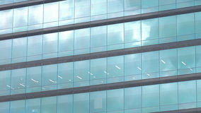 Modern building with glass windows reflected sky Stock Photo
